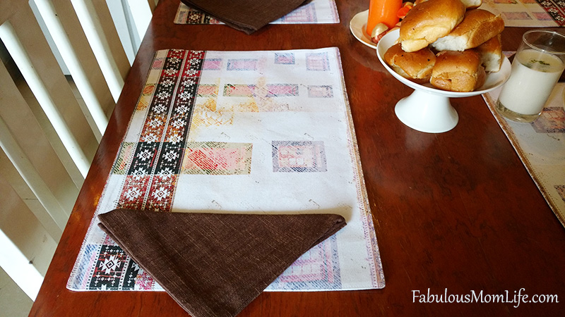 beige and brown placemats and napkins