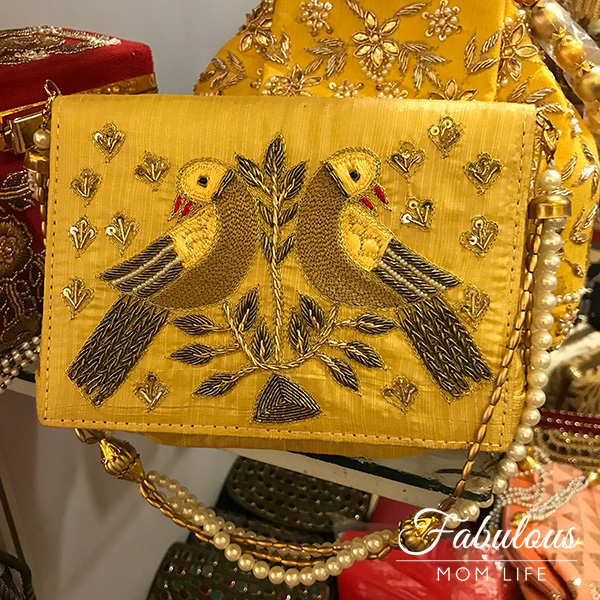 yellow embroidered bird indian clutch bag